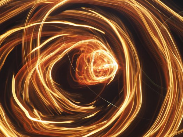 An abstract picture of a ring of fire on black background