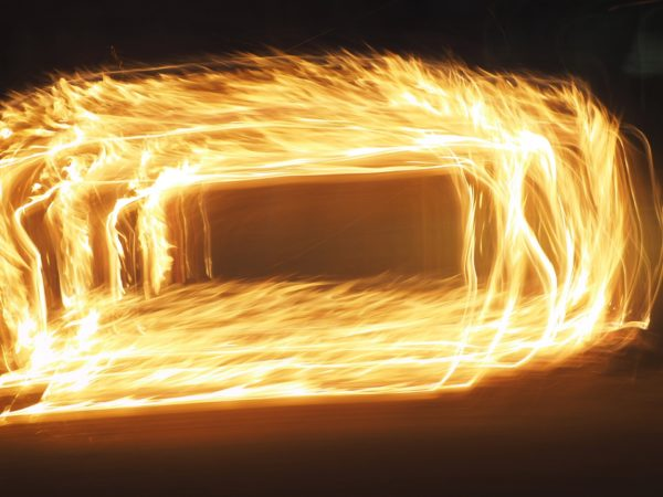 An abstract picture of a flat rectangle 3D tunnel of fire on a black background using light painting technique