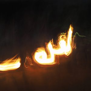 An abstract picture of a arabic style writing made of fire on a black background using light painting technique