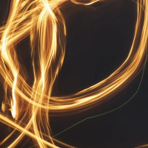 An abstract picture of loose fire brushes on a black background using light painting technique