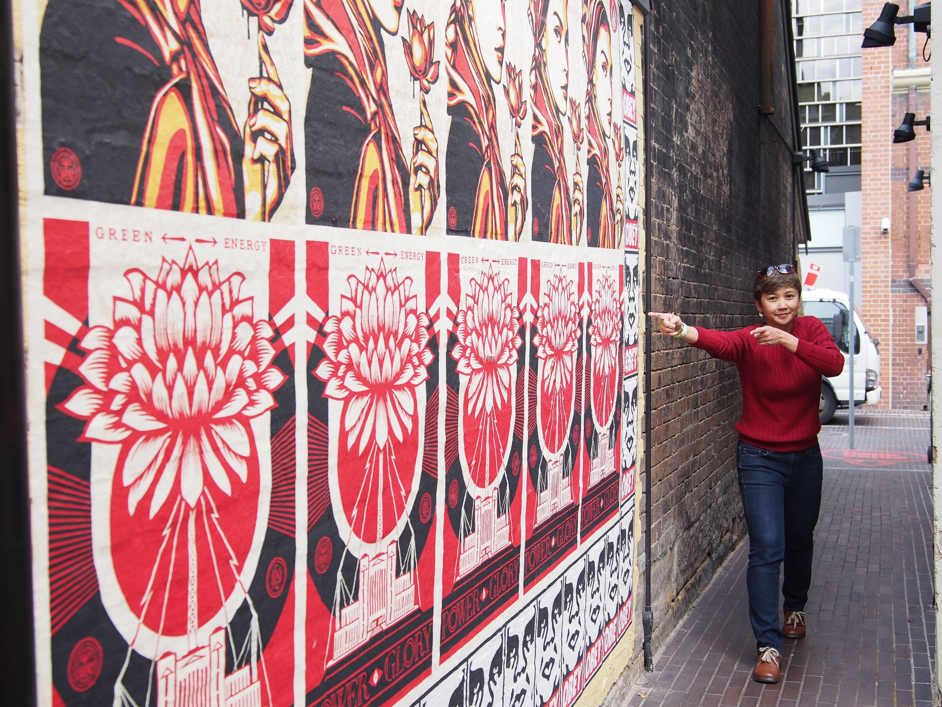 People at Spice Alley net to the Obey Wall Street Art in Sydney